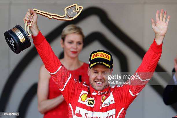 Sebastian Vettel of Germany and Ferrari celebrates his race win on the podium during the Monaco Formula One Grand Prix at Circuit de Monaco on May 28...