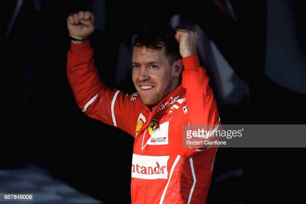 Sebastian Vettel of Germany and Ferrari celebrates his win in parc ferme during the Australian Formula One Grand Prix at Albert Park on March 26 2017...