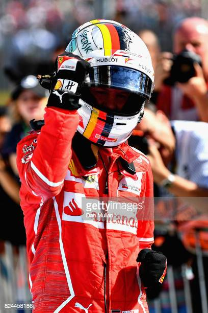 Sebastian Vettel of Germany and Ferrari celebrates his win in parc ferme during the Formula One Grand Prix of Hungary at Hungaroring on July 30 2017...