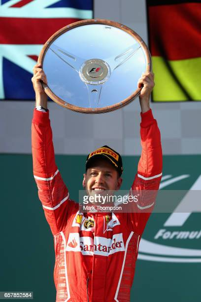 Sebastian Vettel of Germany and Ferrari celebrates his win on the podium during the Australian Formula One Grand Prix at Albert Park on March 26 2017...