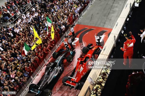 Sebastian Vettel of Germany and Ferrari celebrates his win on the podium during the Bahrain Formula One Grand Prix at Bahrain International Circuit...
