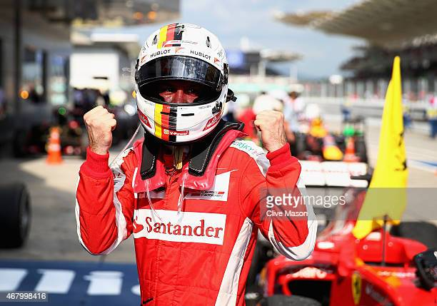 Sebastian Vettel of Germany and Ferrari celebrates in Parc Ferme after winning the Malaysia Formula One Grand Prix at Sepang Circuit on March 29 2015...
