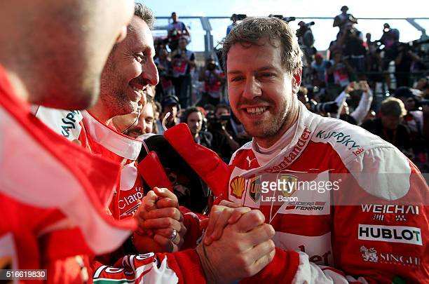 Sebastian Vettel of Germany and Ferrari celebrates in parc ferme with his team after the Australian Formula One Grand Prix at Albert Park on March 20...