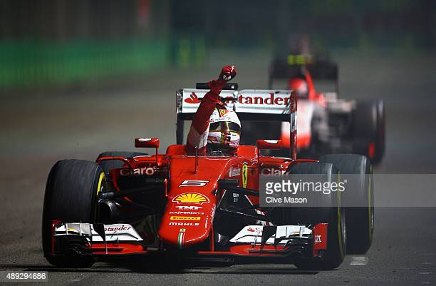 Sebastian Vettel of Germany and Ferrari celebrates in the car after winning the Formula One Grand Prix of Singapore at Marina Bay Street Circuit on...