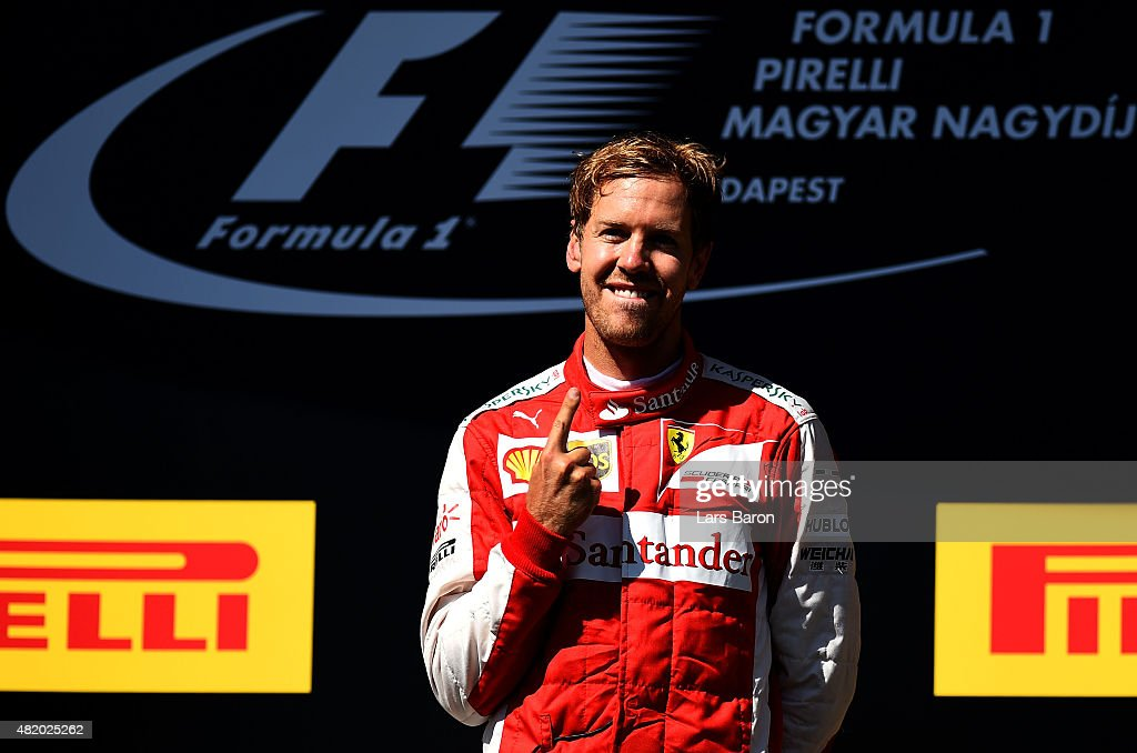 Sebastian Vettel of Germany and Ferrari celebrates on the podium after winning the Formula One Grand Prix of Hungary at Hungaroring on July 26, 2015 in Budapest, Hungary.