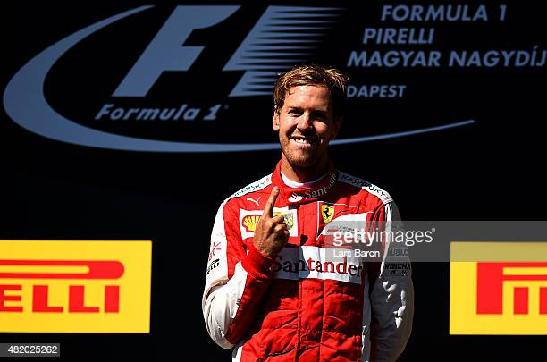 Sebastian Vettel of Germany and Ferrari celebrates on the podium after winning the Formula One Grand Prix of Hungary at Hungaroring on July 26 2015...