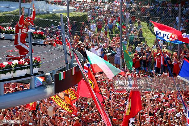 Sebastian Vettel of Germany and Ferrari celebrates on the podium after finishing second in the Formula One Grand Prix of Italy at Autodromo di Monza...