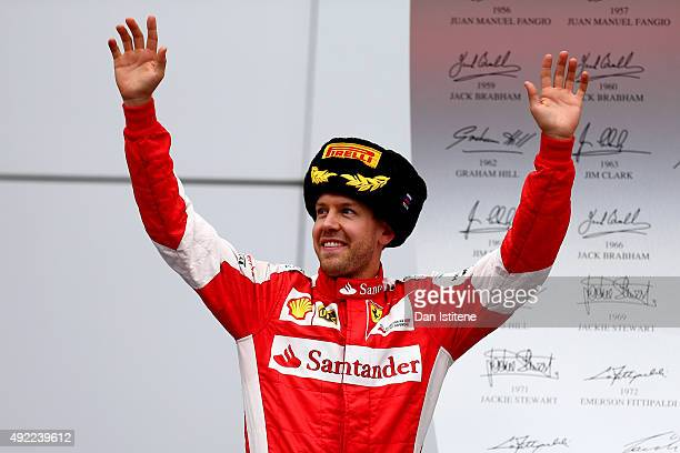 Sebastian Vettel of Germany and Ferrari celebrates on the podium after finishing second in the Formula One Grand Prix of Russia at Sochi Autodrom on...