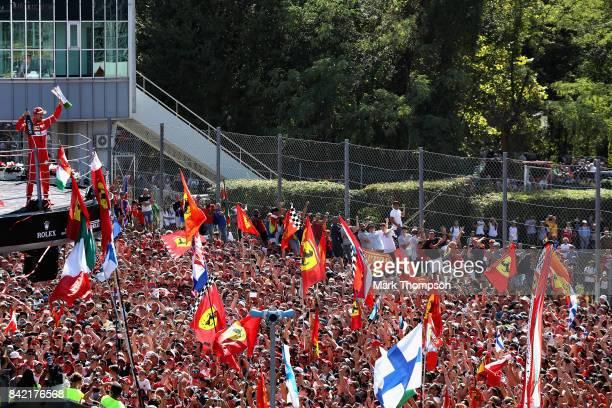 Sebastian Vettel of Germany and Ferrari celebrates on the podium during the Formula One Grand Prix of Italy at Autodromo di Monza on September 3,...