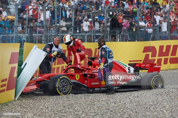 Sebastian Vettel of Germany and Ferrari climbs from the car after crashing during the Formula One Grand Prix of Germany at Hockenheimring on July 22...