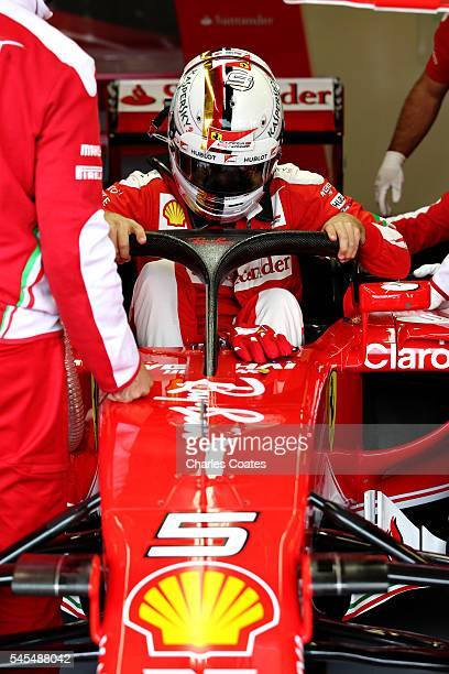 Sebastian Vettel of Germany and Ferrari climbs out of his car in the garage with the halo fitted during practice for the Formula One Grand Prix of...