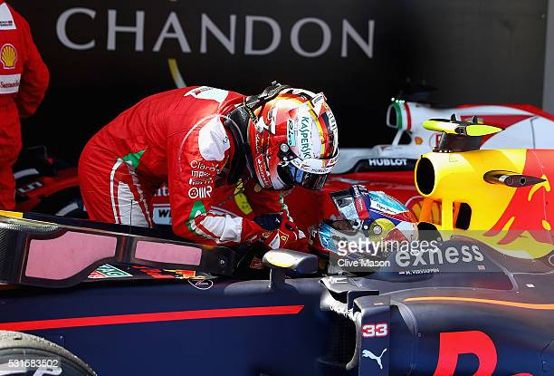 Sebastian Vettel of Germany and Ferrari congratulates Max Verstappen of Netherlands and Red Bull Racing after his first F1 win during the Spanish...