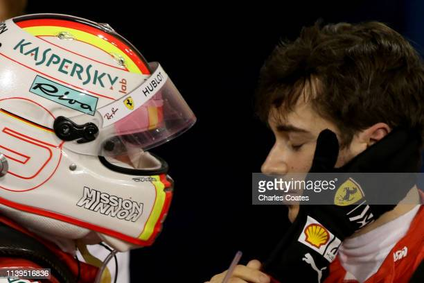 Sebastian Vettel of Germany and Ferrari consoles third placed finisher Charles Leclerc of Monaco and Ferrari in parc ferme during the F1 Grand Prix...