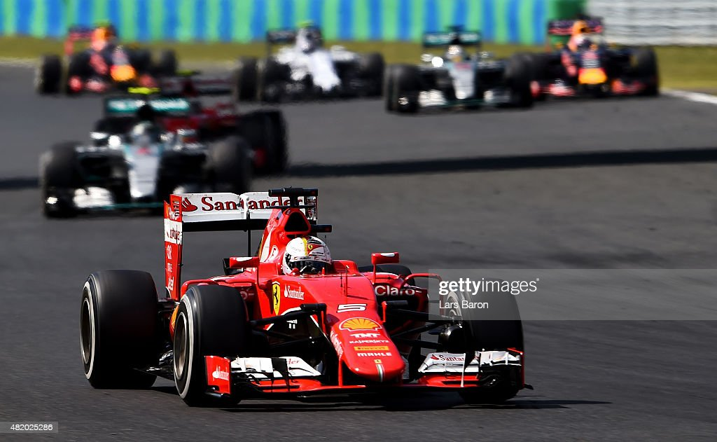 Sebastian Vettel of Germany and Ferrari drives ahead of Nico Rosberg of Germany and Mercedes GP during the Formula One Grand Prix of Hungary at Hungaroring on July 26, 2015 in Budapest, Hungary.