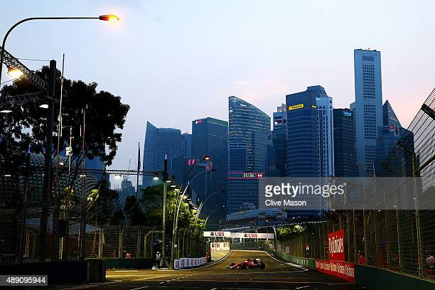 Sebastian Vettel of Germany and Ferrari drives during final practice for the Formula One Grand Prix of Singapore at Marina Bay Street Circuit on...