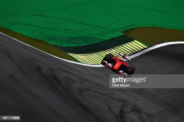 Sebastian Vettel of Germany and Ferrari drives during final practice for the Formula One Grand Prix of Brazil at Autodromo Jose Carlos Pace on...