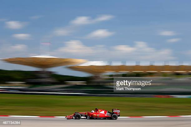 Sebastian Vettel of Germany and Ferrari drives during practice for the Malaysia Formula One Grand Prix at Sepang Circuit on March 27 2015 in Kuala...