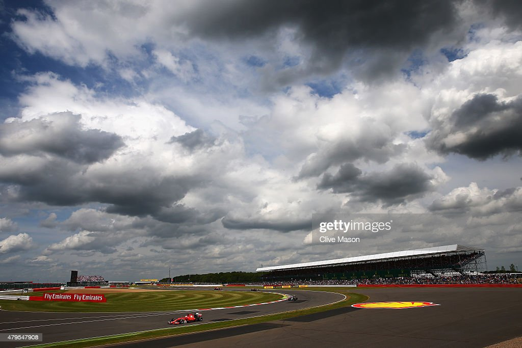 Sebastian Vettel of Germany and Ferrari drives during the Formula One Grand Prix of Great Britain at Silverstone Circuit on July 5, 2015 in Northampton, England.