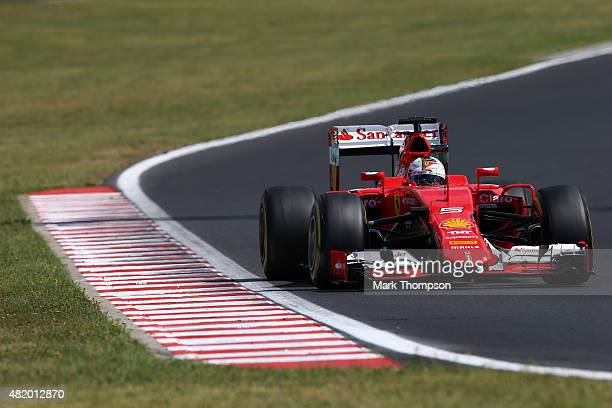Sebastian Vettel of Germany and Ferrari drives during the Formula One Grand Prix of Hungary at Hungaroring on July 26 2015 in Budapest Hungary
