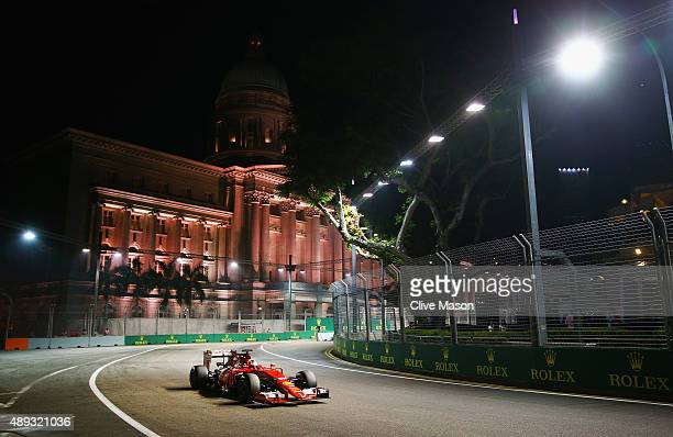 Sebastian Vettel of Germany and Ferrari drives during the Formula One Grand Prix of Singapore at Marina Bay Street Circuit on September 20, 2015 in...