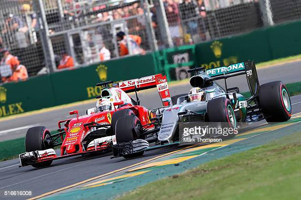 Sebastian Vettel of Germany and Ferrari drives next to Lewis Hamilton of Great Britain and Mercedes GP during the Australian Formula One Grand Prix...