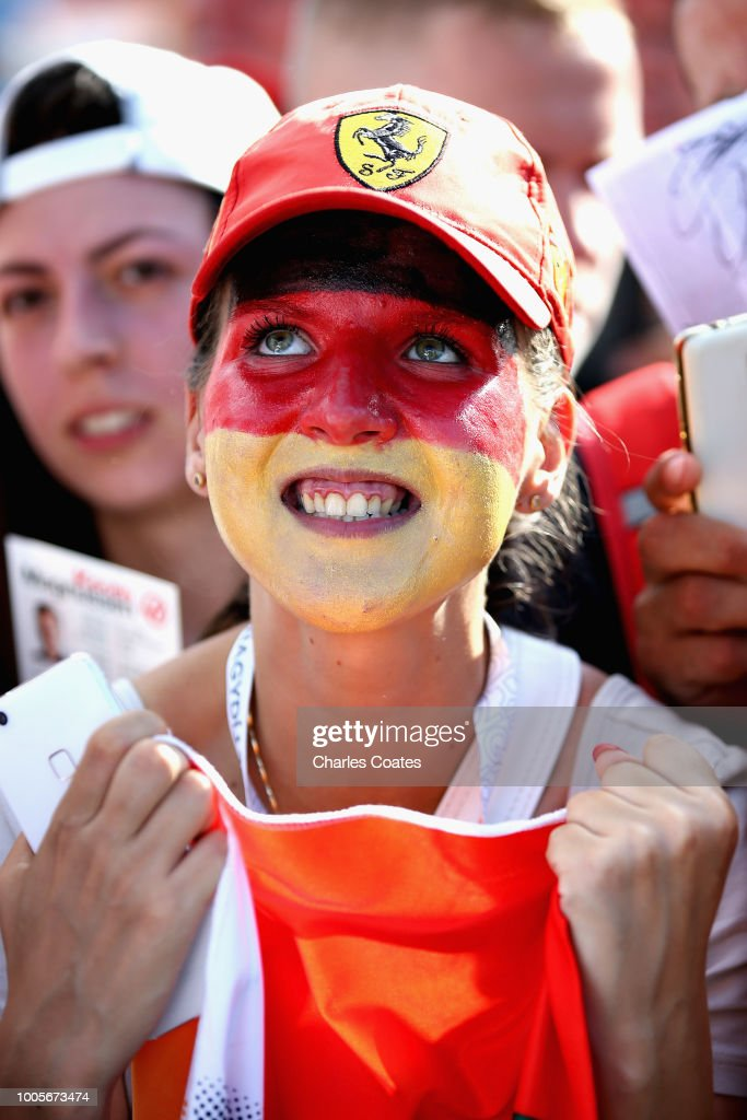 A Sebastian Vettel of Germany and Ferrari fan reacts at the autograph signing session during previews ahead of the Formula One Grand Prix of Hungary at Hungaroring on July 26, 2018 in Budapest, Hungary.