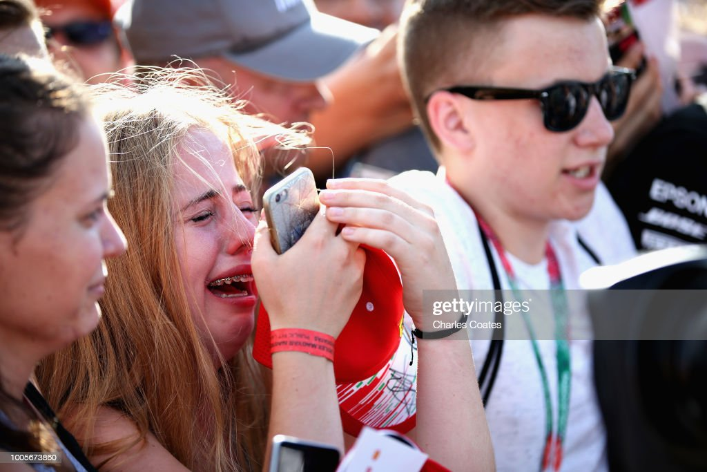 Sebastian Vettel of Germany and Ferrari fans react as he signs autographs during previews ahead of the Formula One Grand Prix of Hungary at Hungaroring on July 26, 2018 in Budapest, Hungary.