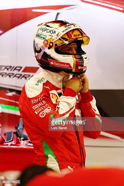 Sebastian Vettel of Germany and Ferrari in the garage during final practice for the Formula One Grand Prix of Singapore at Marina Bay Street Circuit...