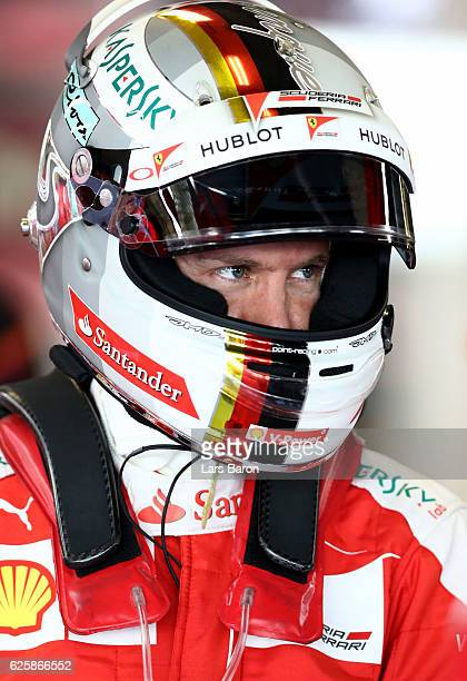 Sebastian Vettel of Germany and Ferrari in the garage during final practice for the Abu Dhabi Formula One Grand Prix at Yas Marina Circuit on...