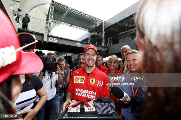 Sebastian Vettel of Germany and Ferrari is greeted by fans in the Paddock during previews ahead of the F1 Grand Prix of Brazil at Autodromo Jose...