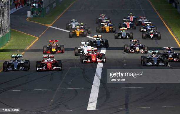 Sebastian Vettel of Germany and Ferrari leads Nico Rosberg of Germany and Mercedes GP Kimi Raikkonen of Finland and Ferrari and Lewis Hamilton of...
