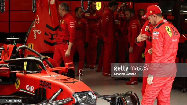 Sebastian Vettel of Germany and Ferrari looks at his car in the garage during Day Two of F1 Winter Testing at Circuit de Barcelona-Catalunya on...