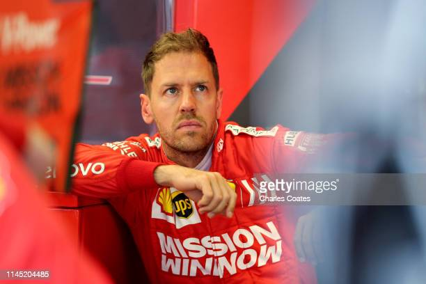 Sebastian Vettel of Germany and Ferrari looks on in the garage during practice for the F1 Grand Prix of Azerbaijan at Baku City Circuit on April 26,...
