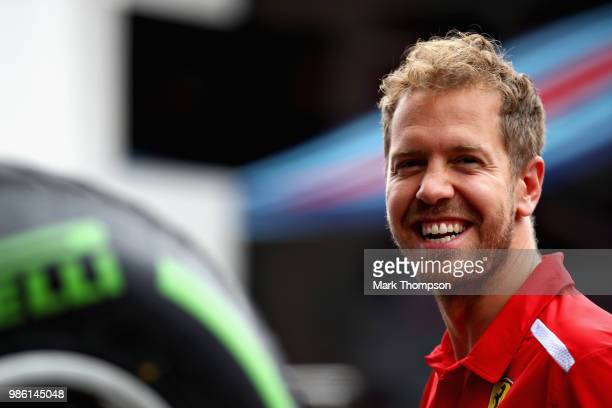 Sebastian Vettel of Germany and Ferrari looks on in the Paddock during previews ahead of the Formula One Grand Prix of Austria at Red Bull Ring on...