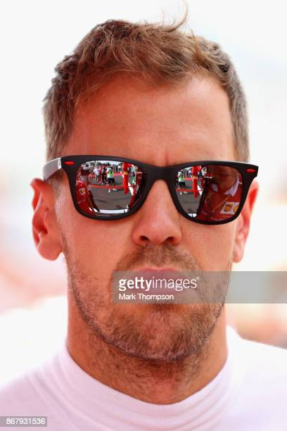Sebastian Vettel of Germany and Ferrari looks on on the grid before the Formula One Grand Prix of Mexico at Autodromo Hermanos Rodriguez on October...