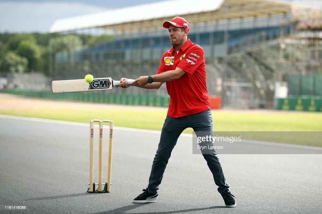 Sebastian Vettel of Germany and Ferrari plays cricket on track ...