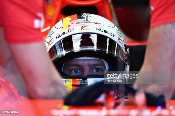 Sebastian Vettel of Germany and Ferrari prepares to drive during practice for the Formula One Grand Prix of Hungary at Hungaroring on July 28 2017 in...