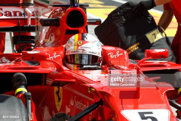HUNGARORING BUDAPEST HUNGARY Sebastian Vettel of Germany and Ferrari prepares to drive during practice for the Formula One Grand Prix of Hungary