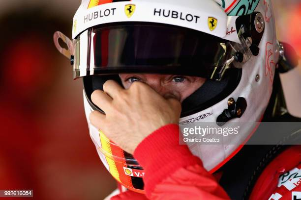 Sebastian Vettel of Germany and Ferrari prepares to drive during practice for the Formula One Grand Prix of Great Britain at Silverstone on July 6...
