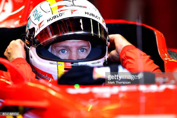 Sebastian Vettel of Germany and Ferrari prepares to drive during final practice for the Formula One Grand Prix of Hungary at Hungaroring on July 29...