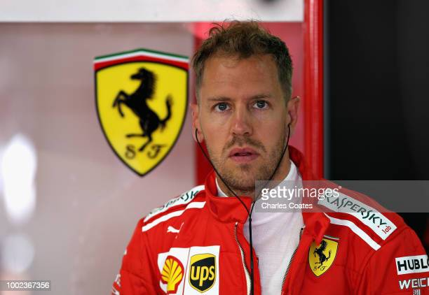 Sebastian Vettel of Germany and Ferrari prepares to drive in the garage during practice for the Formula One Grand Prix of Germany at Hockenheimring...
