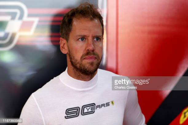 Sebastian Vettel of Germany and Ferrari prepares to drive in the garage during practice for the F1 Grand Prix of France at Circuit Paul Ricard on...