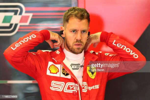 Sebastian Vettel of Germany and Ferrari prepares to drive in the garage before the F1 Grand Prix of Hungary at Hungaroring on August 04, 2019 in...