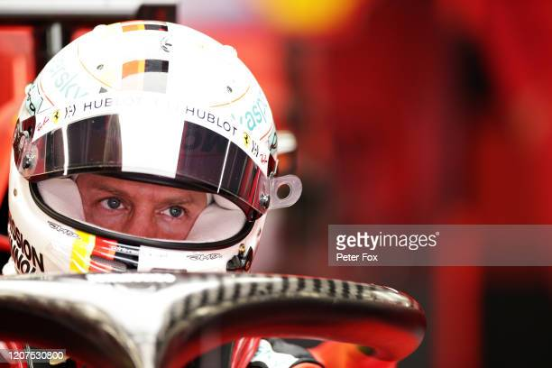 Sebastian Vettel of Germany and Ferrari prepares to drive in the garage during day two of F1 Winter Testing at Circuit de Barcelona-Catalunya on...