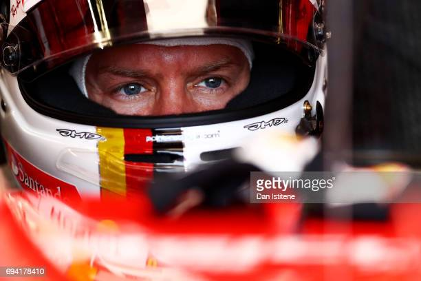 Sebastian Vettel of Germany and Ferrari prepares to drive in the garage during practice for the Canadian Formula One Grand Prix at Circuit Gilles...
