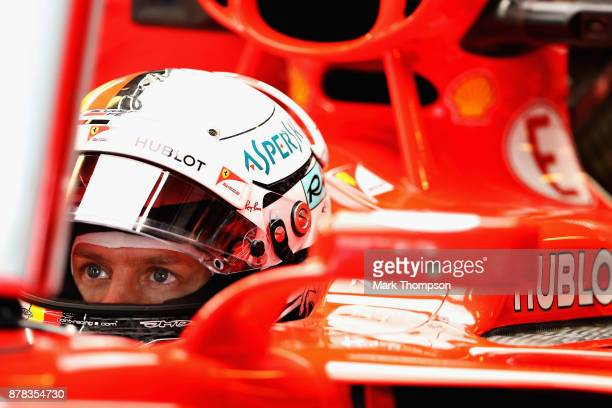 Sebastian Vettel of Germany and Ferrari prepares to drive in the garage during practice for the Abu Dhabi Formula One Grand Prix at Yas Marina...