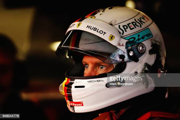 Sebastian Vettel of Germany and Ferrari prepares to drive in the garage during qualifying for the Formula One Grand Prix of China at Shanghai...