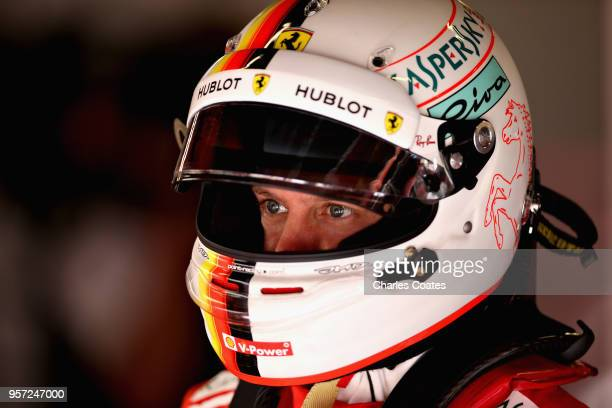Sebastian Vettel of Germany and Ferrari prepares to drive in the garage during practice for the Spanish Formula One Grand Prix at Circuit de...