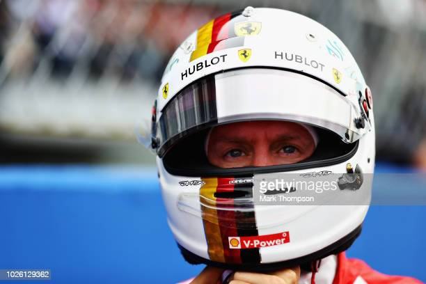Sebastian Vettel of Germany and Ferrari prepares to drive on the grid before the Formula One Grand Prix of Italy at Autodromo di Monza on September 2...