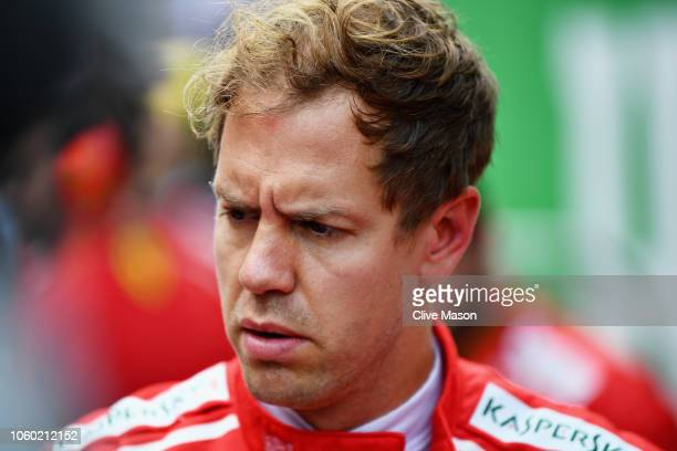 Sebastian Vettel of Germany and Ferrari prepares to drive on the grid before the Formula One Grand Prix of Brazil at Autodromo Jose Carlos Pace on...